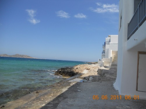View along the rocky sea front in Naoussa.