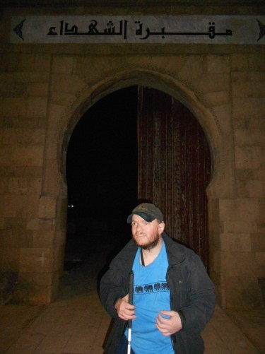 Tony in front of the doorway into Cimitiere Al Shouhada Cemetery, early evening.