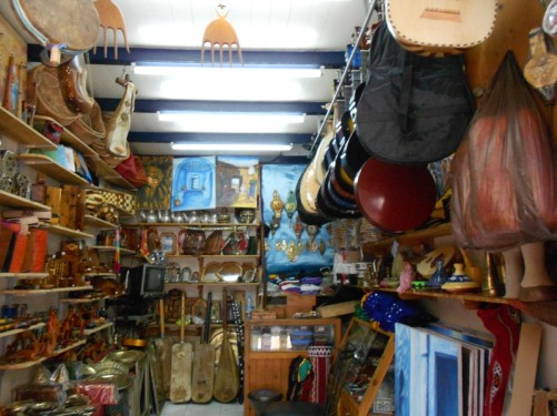 Inside a shop selling musical instruments, as well as paintings and other traditional craft objects.