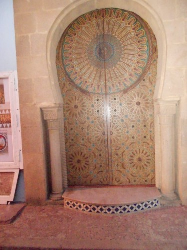 An old-looking door, possibly to a house, covered with geometric/Islamic style decoration. Taken inside the Kasba des Oudaias.
