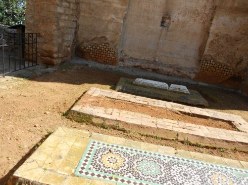 A row of three graves, part of the Islamic cemetery of kings.