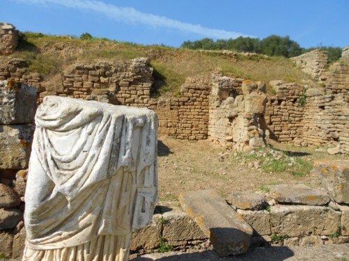 The bottom half of a Roman statue.