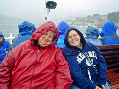Lora and Angela on the boat. View of Dartmouth. Lots of moored boats.