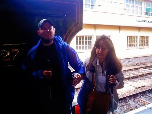 Tony and Tatiana by the steam locomotive at Kingswear station – the other end of the Dartmouth steam railway.