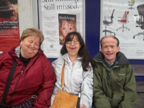 Lora, Tatiana and Paul waiting for a bus in Totnes.