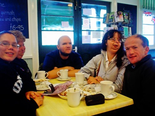 Angela, Lora, Tony, Tatiana and Paul sat indoors at a table in a fish and chip shop, Dartmouth.