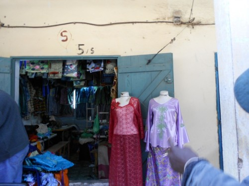 Looking into a small ladies' clothes shop.
