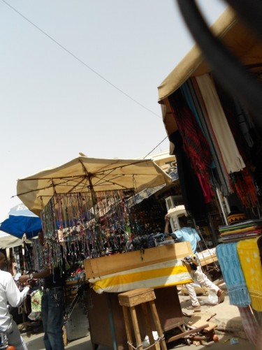 Sandaga, Dakar's largest market, located right in the heart of the city. Stalls selling textiles and jewellery in view.