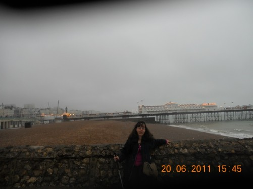 Tatiana on Brighton Beach. View of Brighton Marine Palace and Pier.