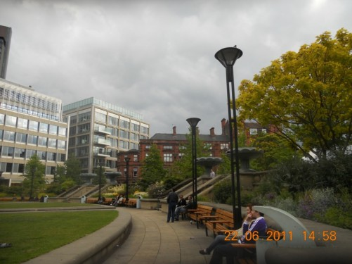 Peace Gardens – benches, flower beds, grass.
