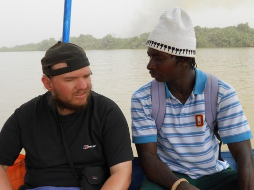 Tony sat next to a park ranger on-board the boat. The ranger is from the Gambia.