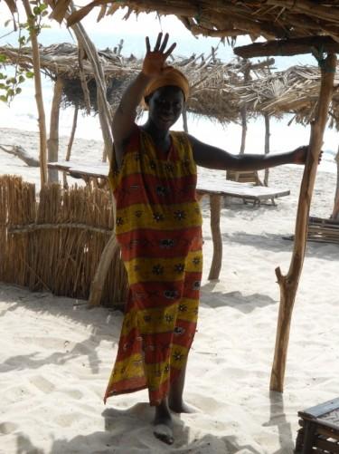 Khady waving at the camera. Abene beach.