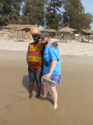 Tony and Khady in the Atlantic Ocean, Abene Beach.