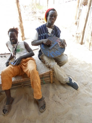 Two local men, the guy playing the calabash is named Eladji.