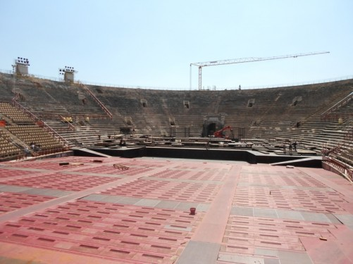 View across the Arena. Rows of seats surround the oval-shaped stage in the middle.