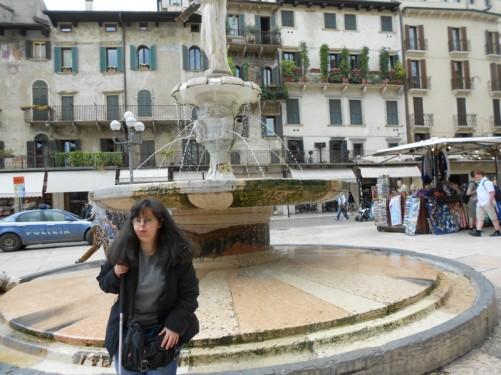 Tatiana by the fountain in Piazza delle Erbe.