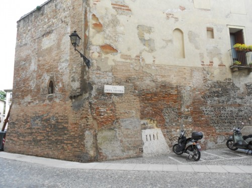 The old wall of a building on Via Pieta Vecchia, near the cathedral.