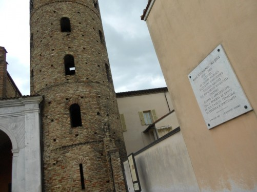 A tall bell tower dating from the 9th or 10th century next to the basilica church.
