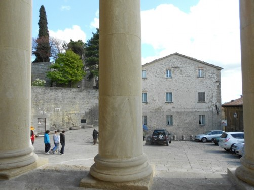 Stone columns outside the basilica, looking down towards the small square in front.