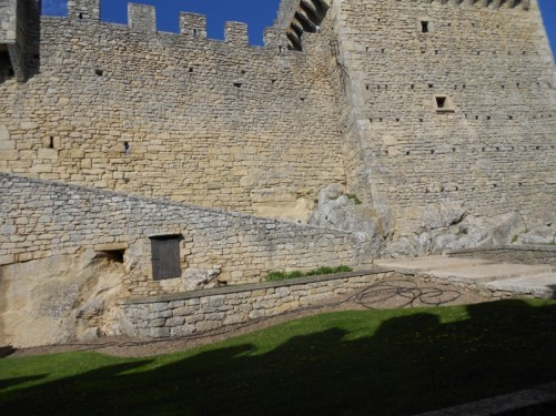 The high castellated walls of the fortress and a tower at one end.