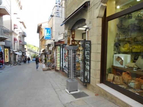 Heading down hill along a shopping street back towards Fratta Gate.