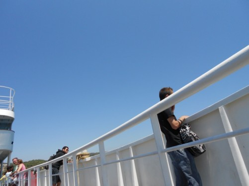 Passengers on the deck of the ferry.