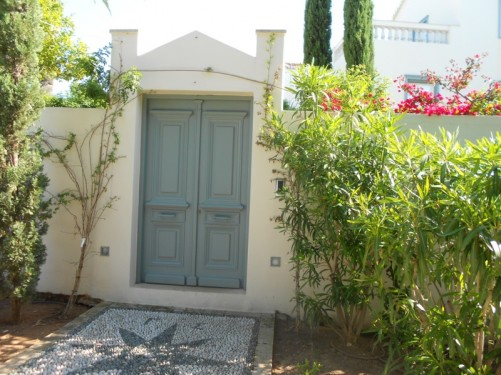 Attractive doorway to a house. Flowers and plants.