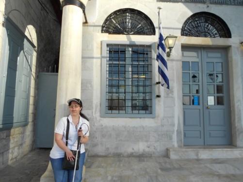 Tatiana outside a building. Hellenic Postbank.