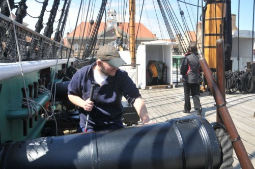 Tony touching a canon on board HMS Trincomalee.