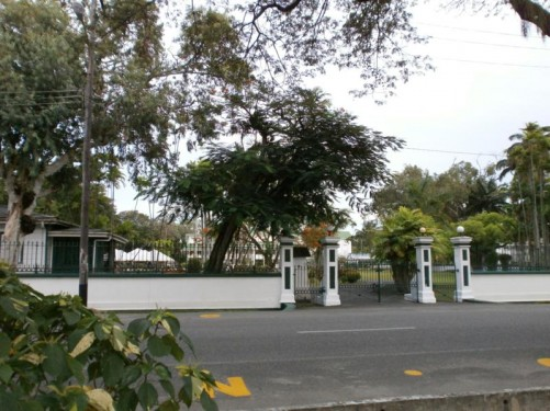 The gates of State House (formerly Government House). The official residence of the President of Guyana. The building dates back to 1858.