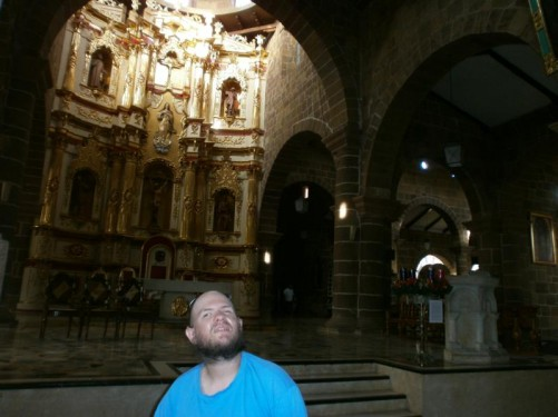 In front of the gold and white main altar.
