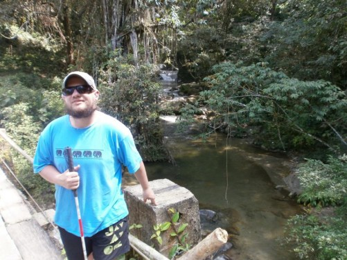 Tony standing on a bridge over a small river. Taken at Minca, a small mountain town, one hour's drive from Santa Marta.