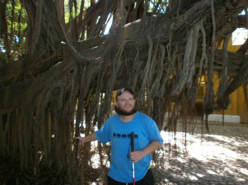 Tony touching roots hanging from a large tree in the grounds of Quinta de San Pedro Alejandrino, Santa Marta. Unofficially the tree is called Barba del Viejo for the dangling roots that look like the beard of an old man. Although the tree is large, it is only about 70 or 80 years old.
