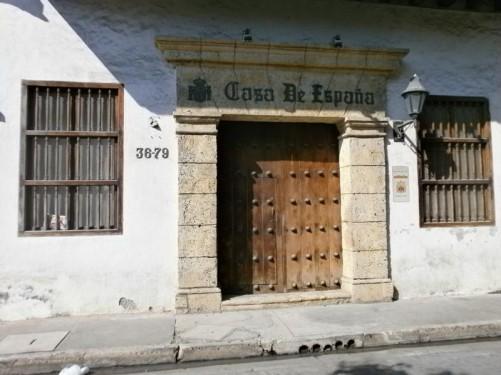 Old wooden doorway into the Casa de España.