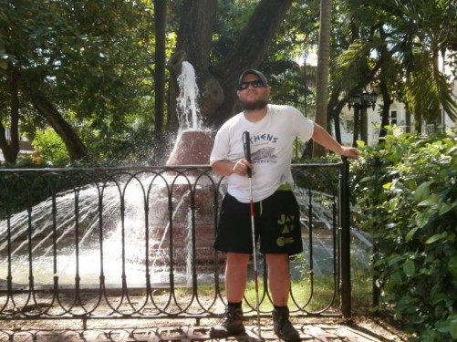 Tony by a fountain in Plaza de Bolívar.