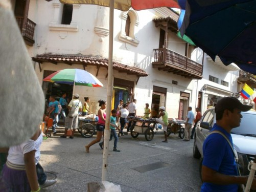 Street scene in the old city. Goods being sold on small carts.