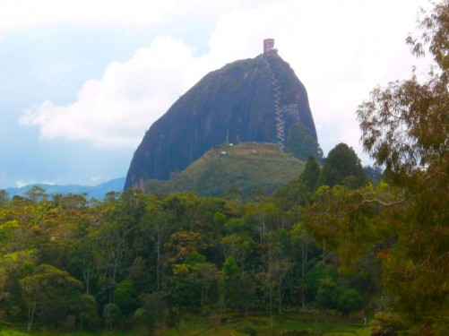 Moving closer to Guatapé Rock. An impressive zig-zagging cascade of steps up the almost vertical side of the rock can be seen. Visitors can climb the 649 plus steps to the top.