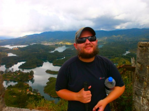 Again Tony on Guatapé Rock. The network of lakes spread out below. Cloud covering the tops of the hills and mountains rising up beyond.