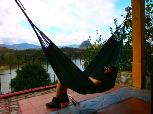 Tony relaxing in a hammock at the wonderful and homely Hostel El Encuentro. A lake down below and Guatapé Rock clearly visible in the distance.