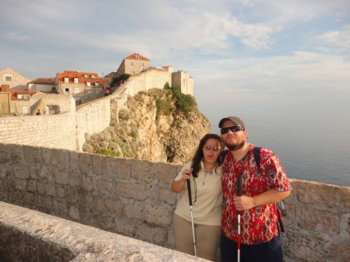 Tony and Tatiana. Nice view of the city walls climbing up the rocky cliff behind and the sea below.