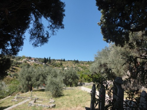 A small Muslim cemetery. View of countryside beyond. Stari Bar.