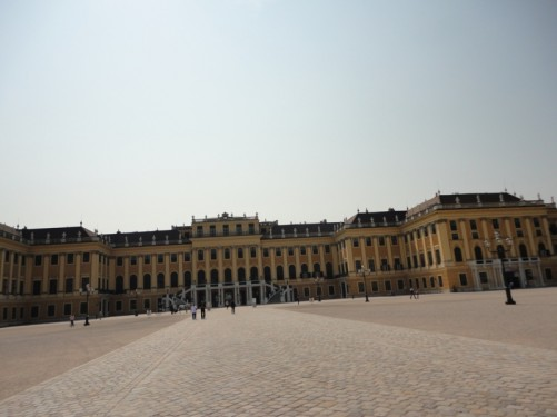 Looking across the courtyard towards the grand main entrance to the Schönbrunn Palace.