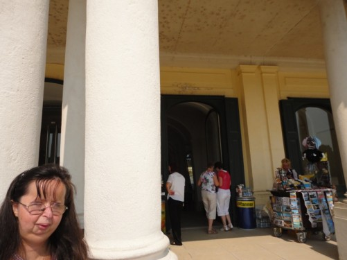 Tatiana standing in front of a column at the entrance.