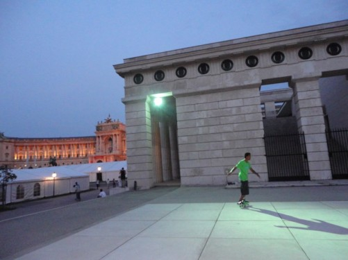 Children skateboarding in Heldenplatz ('Heroes' Square') during the evening. The square is faced by the Hofburg Palace, one of Vienna's main attractions.