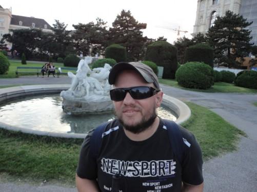 Tony by a fountain in Maria-Theresien-Platz.