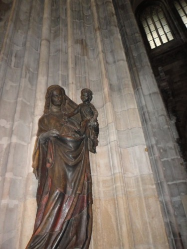 A bronze statue of the Virgin Mary and baby Jesus.
