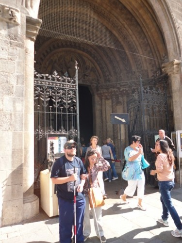 Tatiana, Tony back on ground level outside the main entrance to the Cathedral known as Giant's Door.