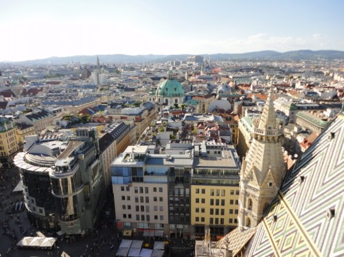 Another view of the cathedral's mosaic roof tiles and the city skyline beyond.