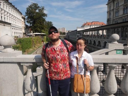 Tony and Tatiana stood on the Triple Bridge.
