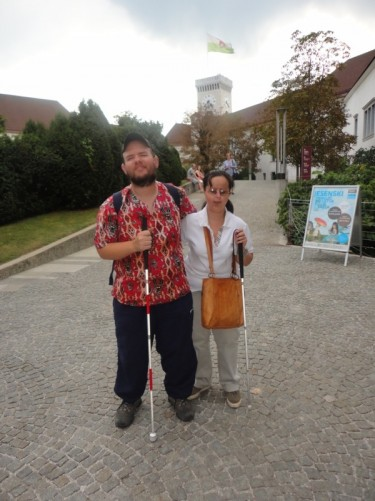 Tony and Tatiana outside Ljubljana Castle. It is located on a hill overlooking the city on a site which has been occupied since 1200 BC. In the background is the castle's Outlook Tower, which dates from 1848.